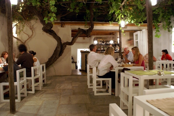 A stunning, 200-year-old grapevine dominates the courtyard dining area